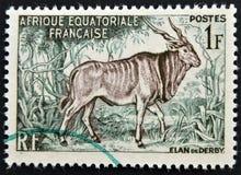 En stämpel som skrivs ut i franska ekvators- Afrika, visar Royaltyfri Fotografi
