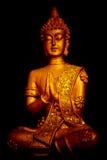 En staty av Buddha Royaltyfria Bilder