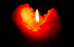 En stearinljusflamma på natten Arkivfoto
