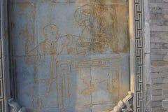 En sten som snider på ingången av en tebjudning i den dongguan gatan i yangzhou Royaltyfria Foton
