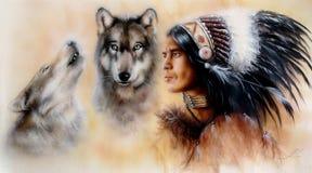 En stående av en ung courrageous indisk krigare med ett par av varger Arkivfoto