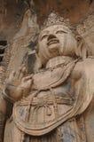 Stena skulptur av bodhisattvaen i Longmen Grottoes, Luoyang, Henan, Kina Arkivfoto