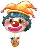 En stor clownballong med ungar i den stora korgen Royaltyfri Foto