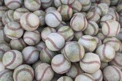En stor hög eller grupp av baseball Arkivfoto
