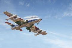 En stråle av det italienska nationella aerobatic laget som är bekant som Frecce Tr fotografering för bildbyråer
