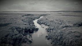 En stre som leder till floden Severn Royaltyfri Bild