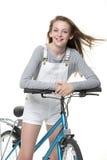 En su bici Imagen de archivo libre de regalías