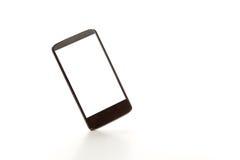 En svart mobiltelefon Arkivfoton