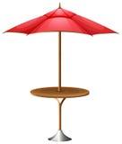 En tabell med ett paraply Royaltyfri Bild