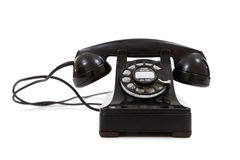 En tappning, svart telefon på en vit bakgrund Royaltyfria Foton