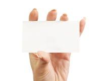 En tarjeta de la mano de s de las mujeres ' Foto de archivo