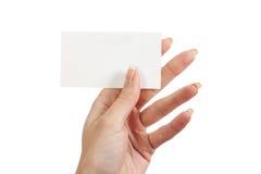 En tarjeta de la mano de s de las mujeres ' Fotos de archivo