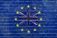 En tegelstenvägg med en flagga av Storbritannien inom flaggan av den europeiska unionen Royaltyfri Fotografi