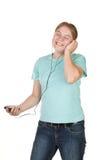 En tiener die zingt danst Stock Foto's