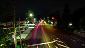 En timelapse av den i stadens centrum gatan på OUME-avenyn i bred skjuten lutande Tokyo för lång exponering stock video