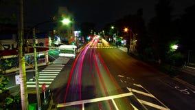 En timelapse av den i stadens centrum gatan på den Oume avenyn i bred skjuten zoom Tokyo för lång exponering arkivfilmer