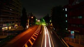 En timelapse av den i stadens centrum gatan på den Oume avenyn i brett skott Tokyo för lång exponering stock video