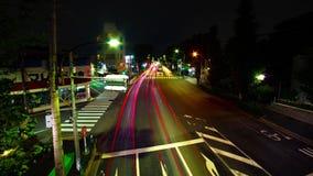 En timelapse av den i stadens centrum gatan på den Oume avenyn i brett skott Tokyo för lång exponering arkivfilmer