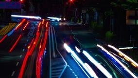 En timelapse av den i stadens centrum gatan på OUME-avenyn i Tokyo lång exponering lager videofilmer