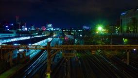 En timelapse av drevet p? den Ueno stationen p? skottet f?r l?ng exponering f?r natt det breda arkivfilmer