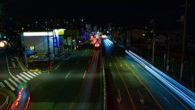 En timelapse av gatan p? centret i Tokyo p? l?ng exponering f?r natten sk?t vitt att panorera stock video