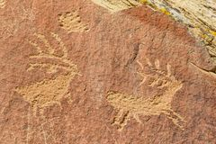 En Toto Pecked Zoomorphs. Are a style of Petroglyphs made within the last 2000 years stock photos