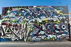 En tryckvåg av grafitti Royaltyfri Bild
