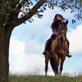 En un caballo Imágenes de archivo libres de regalías