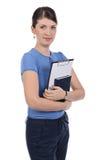 En ung affärskvinna med en clipboard Arkivbild
