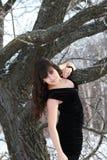 En ung flicka i en svart klänning Royaltyfria Foton