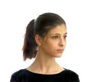 En ung flicka med mörkt hår Arkivbild