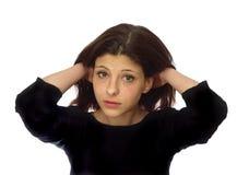 En ung flicka med mörkt hår Royaltyfri Fotografi
