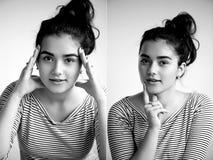 en ung flicka ser öppen säker blick Två händer av en person Om något som försöker collagebrunett på en vit royaltyfri fotografi