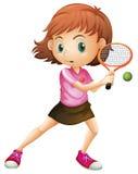 En ung flicka som spelar tennis Fotografering för Bildbyråer