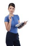 En ung kvinna med en anteckningsbok Arkivbilder