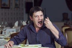 En ung man äter middag Royaltyfria Bilder