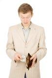 En ung man visar att han har i plånboken per en dollar Arkivbilder