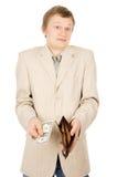 En ung man visar att han har i plånboken per en dollar Royaltyfria Foton