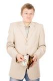 En ung man visar att han har i plånboken per en dollar Royaltyfri Foto