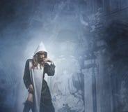 En ung och sexig nunna i en mörk klänning och damunderkläder Royaltyfri Fotografi