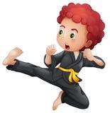 En ung pojke som gör karate stock illustrationer