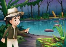 En ung pojke som pekar journalen med alger Royaltyfria Foton
