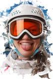 En ung snowboardflicka som bär en hjälm, och exponeringsglas satte ut hennes tunga Royaltyfri Bild
