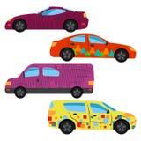 En uppsättning av fyra bilar målade i olika färger Arkivbild