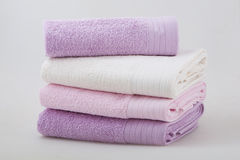 En uppsättning av fyra handdukar Arkivbild