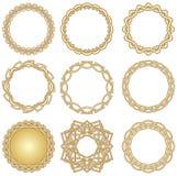 En uppsättning av guld- dekorativa cirkelramar i art décostil Arkivfoton