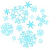 En uppsättning av härligt, jul, snidit nytt år, festliga unika blått-, turkos- och vitsnöflingor av olika former och format royaltyfri illustrationer