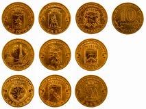 En uppsättning av jubileums- mynt på en vit bakgrund, 2011 Arkivfoto