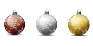 En uppsättning av julgranbollar Arkivbild