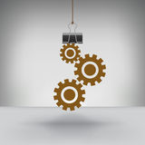 En uppsättning av kugghjul som hängs av ett limbindninggem Arkivfoton